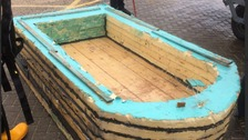 Homemade boat made out of plywood, insulation boards and coat-hangers.