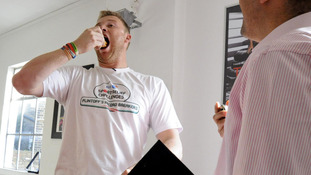 Freddie Flintoff practising eating chocolate eclairs before taking on The BT Sport Relief Challenge