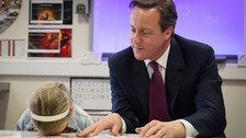 Lucy Howarth, six, takes a desk break during David Cameron's storytelling session