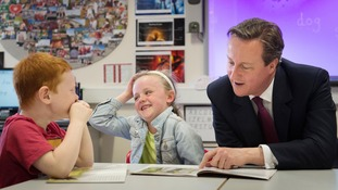 Prime Minister David Cameron reads at Sacred Heart Roman Catholic Primary School in Westhoughton near Bolton