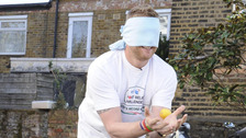 Freddie Flintoff practising catching lemons before taking on The BT Sport Relief Challenge