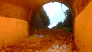 A view of the tunnel shortly after the collapse, before it was realised a car lay under the mud
