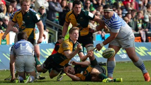 Will Hooley (centre) in action for Northampton Saints.