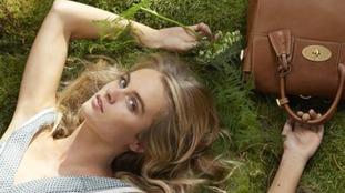 Cressida Bonas models with Cara Delevigne bag