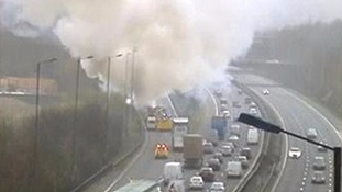 coach on fire on M25 sliproad