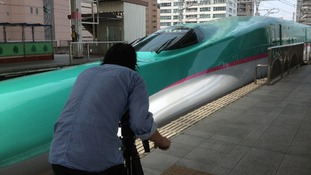 Meridian cameraman Naoya Issa films a bullet train in Japan