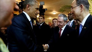 Obama shakes hands with Cuban President Castro.