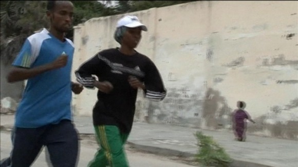 The athletes on a training run through the streets of Mogadishu. 