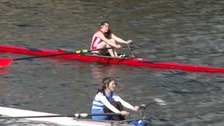 Two rowers compete in single sculls