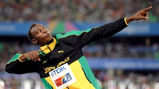 "Usain Bolt striking his famous ""To Di World"" pose"