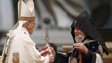 Pope Francis embraces Catholicos of All Armenians Karekin II during a mass.