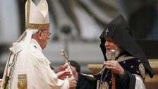 Pope Francis embraces Catholicos of All Armenians Karekin II during a mass.