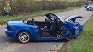 The convertible sports car after a crash in Leamington yesterday