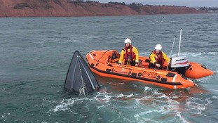 Inshore lifeboat, George Bearman crew volunteers stay on scene to watch  over the sinking motorboat