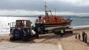 All-weather lifeboat Shannon class R and J Welburn launches on  Exmouth Beach