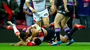 Wigan Warriors Ben Flower fights with St Helens Paul Wellens.