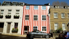 The house in Kensington, which has recently been painted in red and white stripes