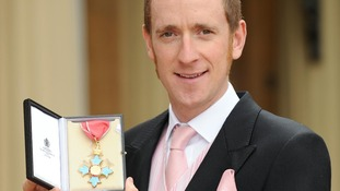 Bradley Wiggins outside Buckingham Palace after being awarded an CBE by the Prince of Wales in June 2009
