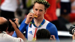 Great Britain's Bradley Wiggins kisses his gold medal at the ceremony