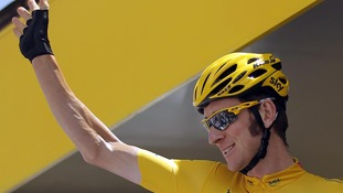 Bradley Wiggins of Britain waves to spectators during the 99th Tour de France
