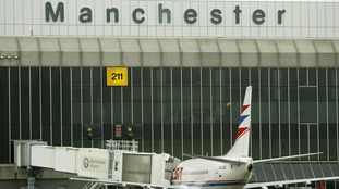 Four people have been arrested at Manchester airport on suspicion of terrorism