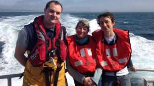 A paddle boarder who was rescued by the RNLI after drifting for six hours in freezing seas has met his rescuers