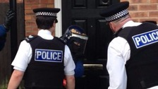 Police raiding a house in Merseyside today.