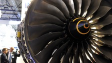 Expo visitors look at a Rolls Royce engine Trent 1000 at the ILA Berlin Air Show 2014 in Selchow, Germany,