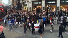 Crowds near the closed Oxford Circus station last night