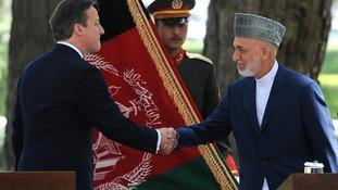 Prime Minister David Cameron and Afghan President Hamid Karzai.