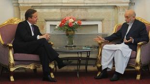 Prime Minister David Cameron meets Afghan President Hamid Karzai.