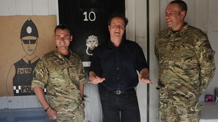 David Cameron meets British soldiers at Camp Bastion who made a mock up Number 10.