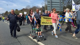 Hundreds turn out for hospital protest march