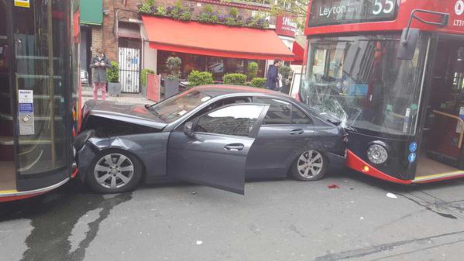 Collision leaves car caught between two buses | London ...