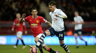 Preston North End's Joe Garner (right) and Manchester United's Angel Di Maria in action during the FA Cup Fifth Round match at Deepdale.