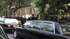 Coffin leaves churchyard