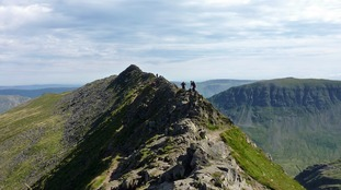 Generic image: Walkers make their way along Striding Edge towards the summit of Helvellyn in the Lake District National Park.