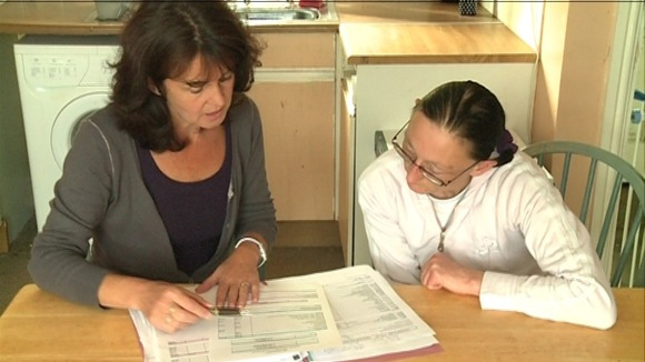 Counting the cost: Charity worker Jill Wheatley helps a client with debt problems
