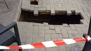 Woman vanishes with shopping trolley down huge hole that 'opened like a trapdoor'
