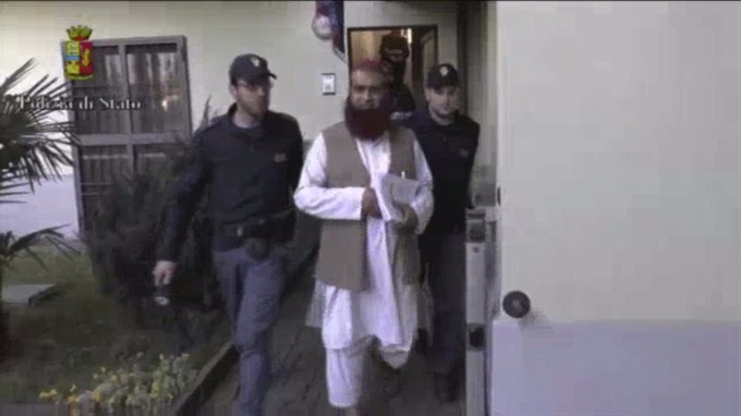 talian Policemen detain a man suspected to be member of an armed organisation inspired by al Qaeda in this still image taken from a video released by Italian Police.