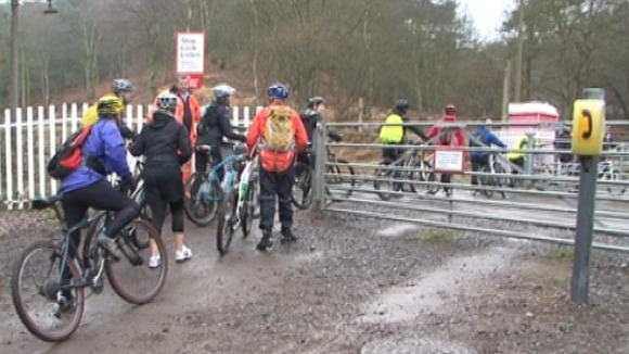 Cyclists at the Moors Gorse level crossing near Hednesford in Staffordshire