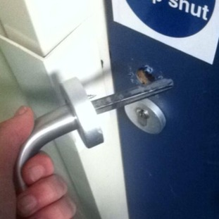 A door handle comes off in a student's hand