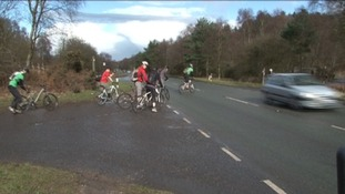 Cyclists crossing the A460 near Cannock Chase