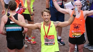 Formula 1 hunk Jenson Button gives a wave
