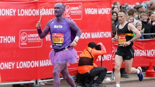 A man dressed as a blackcurrant fairy, perhaps