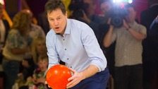 Liberal Democrat leader Nick Clegg takes part in ten-pin bowling during a General Election campaign visit to Colchester, Essex.