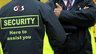 G4S Security guards outside the USA training base at Alexandra Stadium, Birmingham