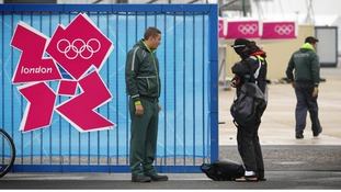 A G4S employed security guard checks an athlete's accreditation