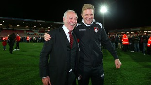 Bournemouth manager Eddie Howe (right) and Chairman Jeff Mostyn celebrate on the pitch