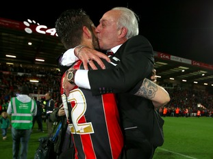 Bournemouth's Elliott Ward (left) is kissed by Chairman Jeff Mostyn after the final whistle
